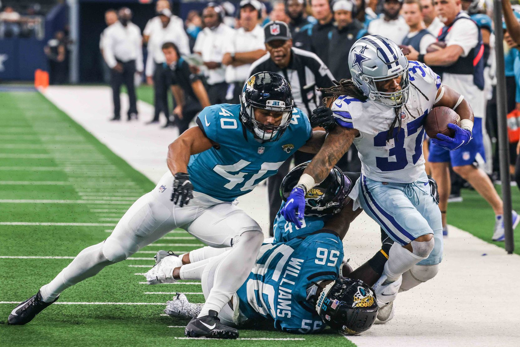 Dallas Cowboys running back JaQuan Hardy, 37, gets pushed out of the sideline by Jacksonville Jaguars defense during a preseason game at AT&T stadium in Arlington on Sunday, August 29, 2021.