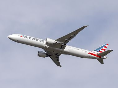 An American Airlines Boeing 777-300 takes off from DFW International Airport on Sept. 3.