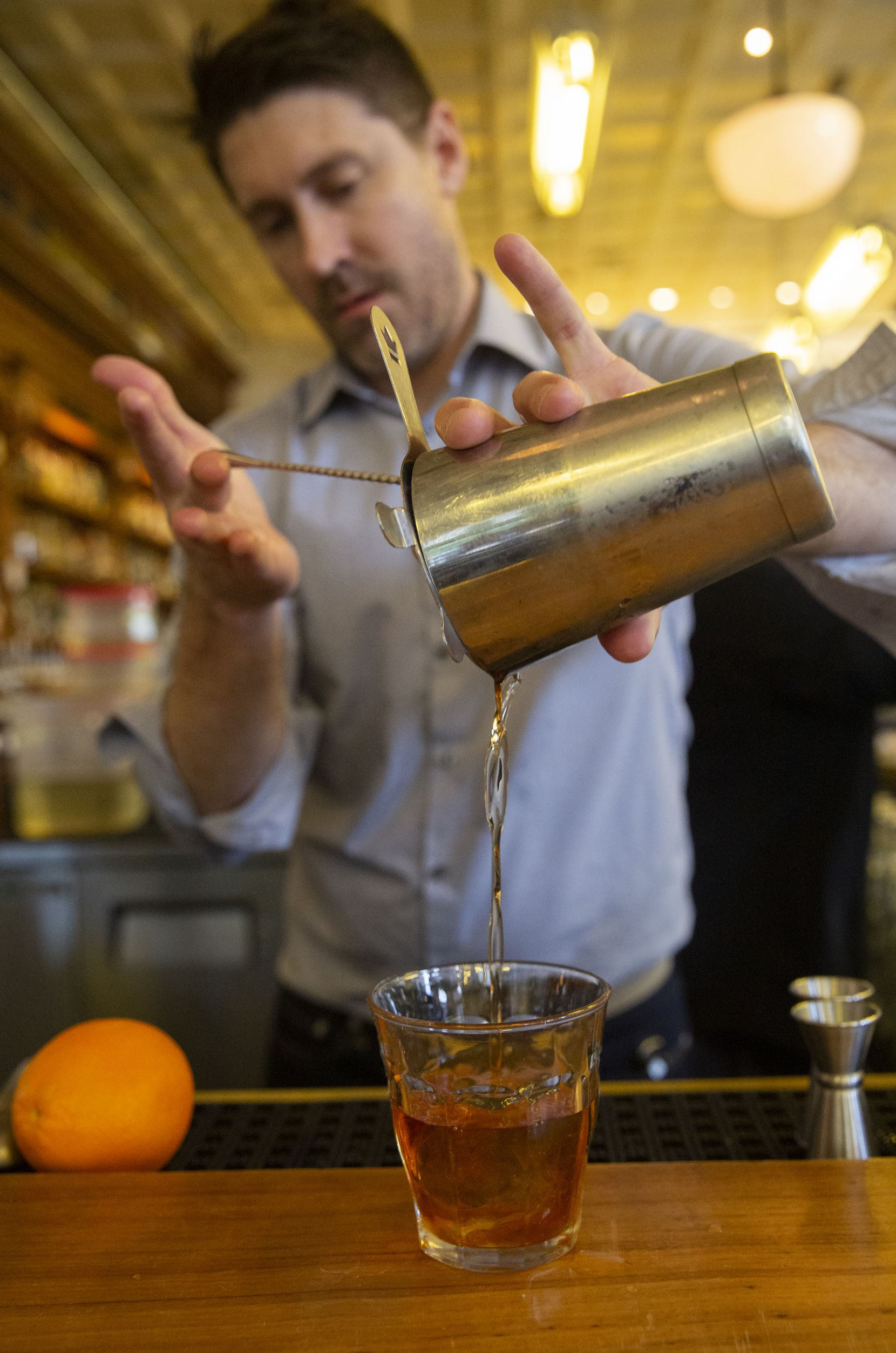 Abraham Bedell pours an old-fashioned made with the Maker's Mark Private Select single barrel spirit at Billy Can Can in Dallas.