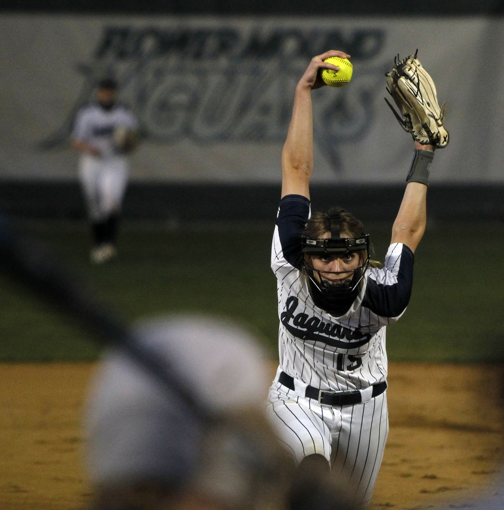 Flower Mound sophomore pitcher Landrie Harris (15) goes through her wind-up before delivering a pitch to a Plano batter during the top of the 2nd inning of play. The two teams played their District 6-6A softball game at Flower Mound High School in Flower Mound on March 23, 2021. (Steve Hamm/ Special Contributor)