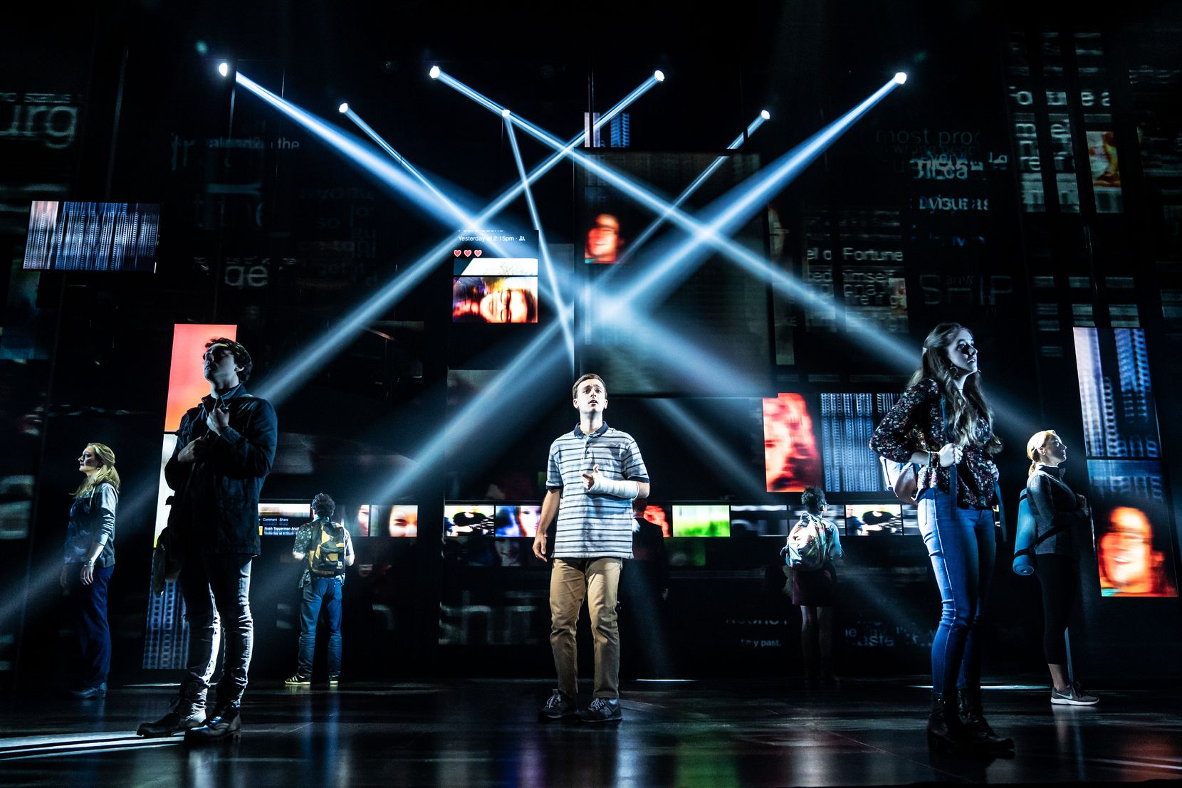 """Against a projected social media backdrop, Stephen Christopher Anthony, center, stars as the title character in the national touring production of """"Dear Evan Hansen."""""""