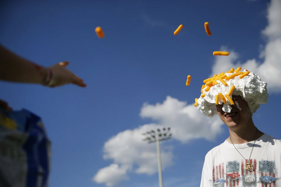 Cheetos are so versatile, aren't they? Anthony Parker, 7, throws Cheetos at family friend Joshua Stockwell (right), while playing a game at Allen USA Celebration in 2015.