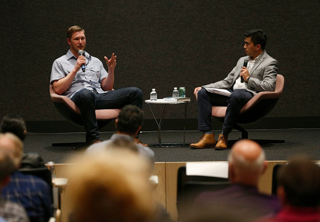 "Journalist and author Brantley Hargrove (left) talked with Jesus Jimenez, Dallas Morning News weather reporter, during a ""Duets"" conversation on the weather in the Morning News' auditorium in Dallas on May 8."