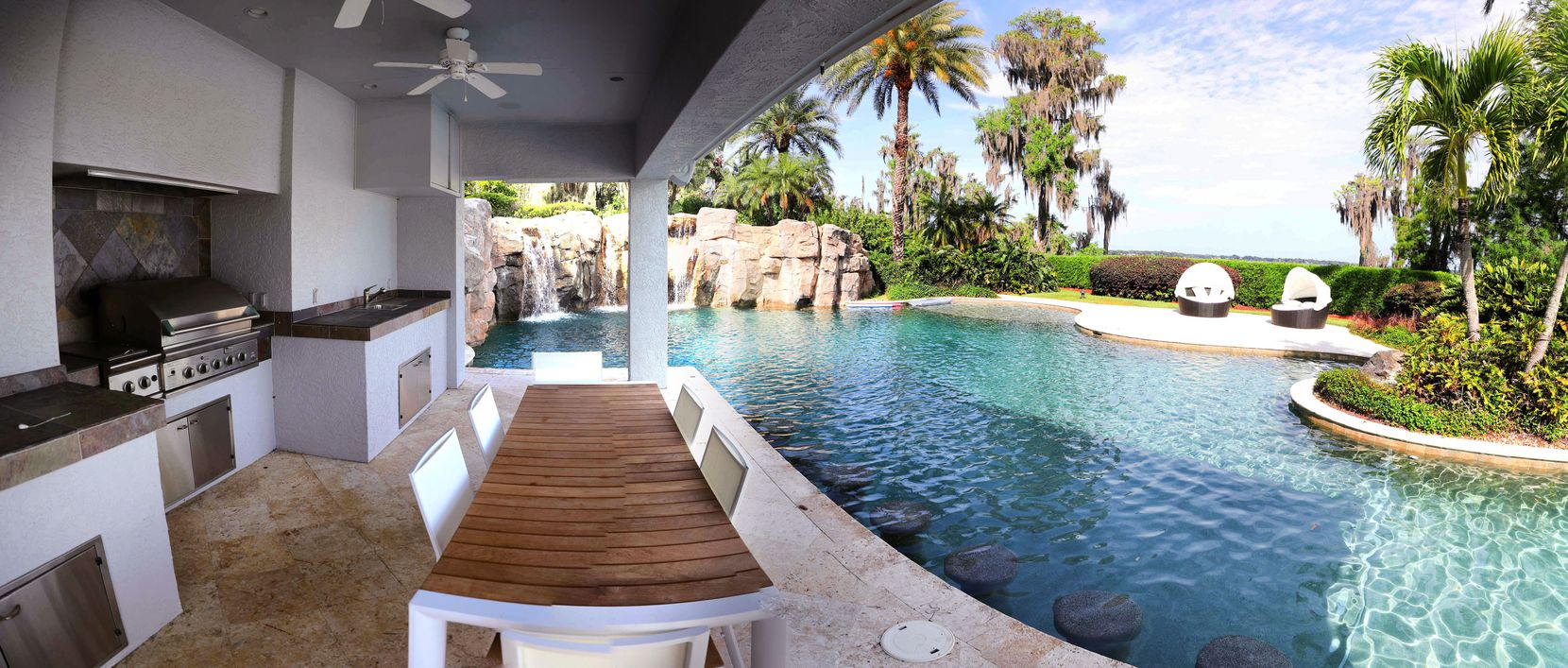 The 31,000 square foot home has a lagoon pool and an outdoor kitchen.