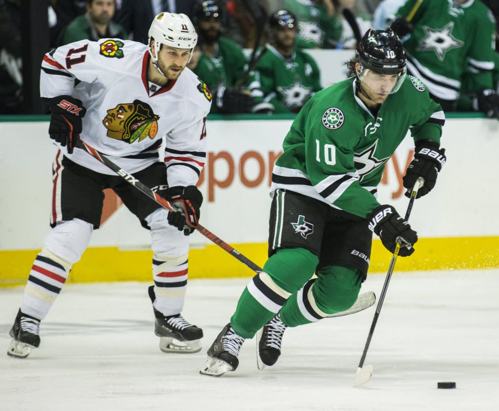 Dallas Stars left wing Patrick Sharp (10) gets ahead of Chicago Blackhawks center Andrew Desjardins (11) during the second period of their game on Tuesday, December 22, 2015 at the American Airlines Center in Dallas. (Ashley Landis/The Dallas Morning News)