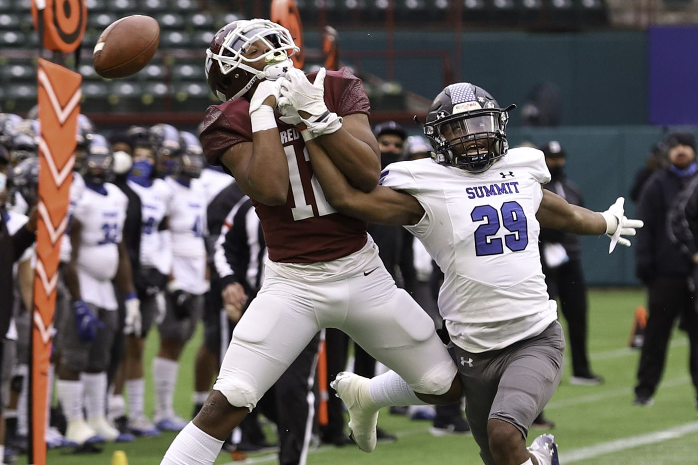 Mansfield Summit defensive back Aiden Armstrong (29) breaks up a pass intended for Red Oak wide receiver Jace Wyatt (12) during the first half at Globe Life Park in Arlington, Texas, Friday, Jan. 1, 2021. (Elias Valverde II / Special Contributor)