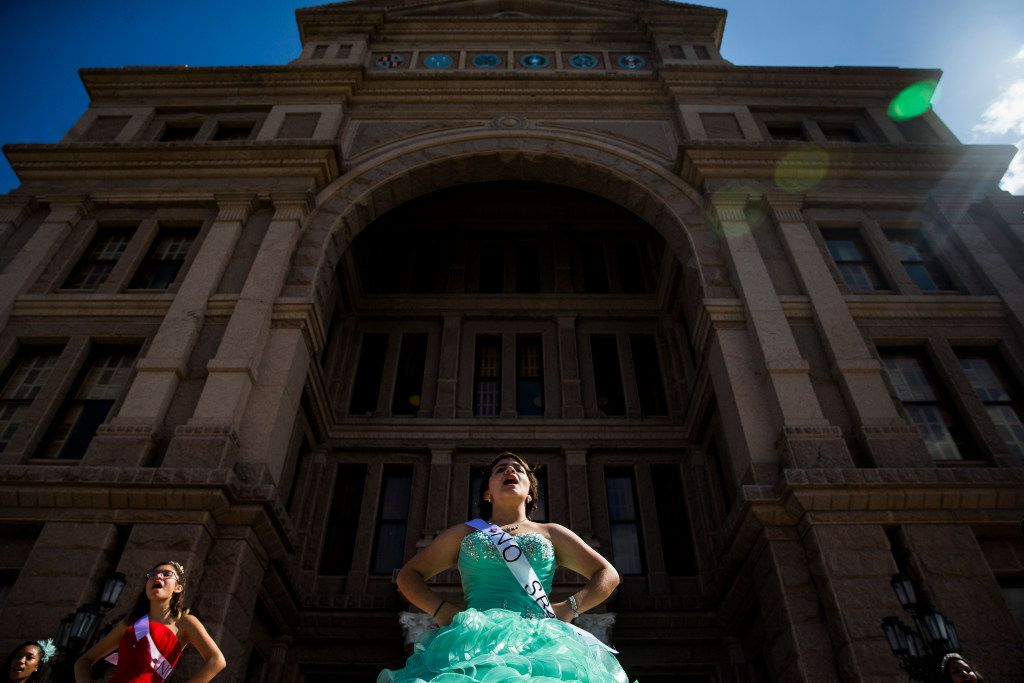 "Jennifer Ramirez, 16, wears a ""No SB4"" sash as she and other teenage girls with Jolt Texas hold symbolic quinceaneras to protest the sanctuary cities ban on Wednesday outside the Texas Capitol in Austin."