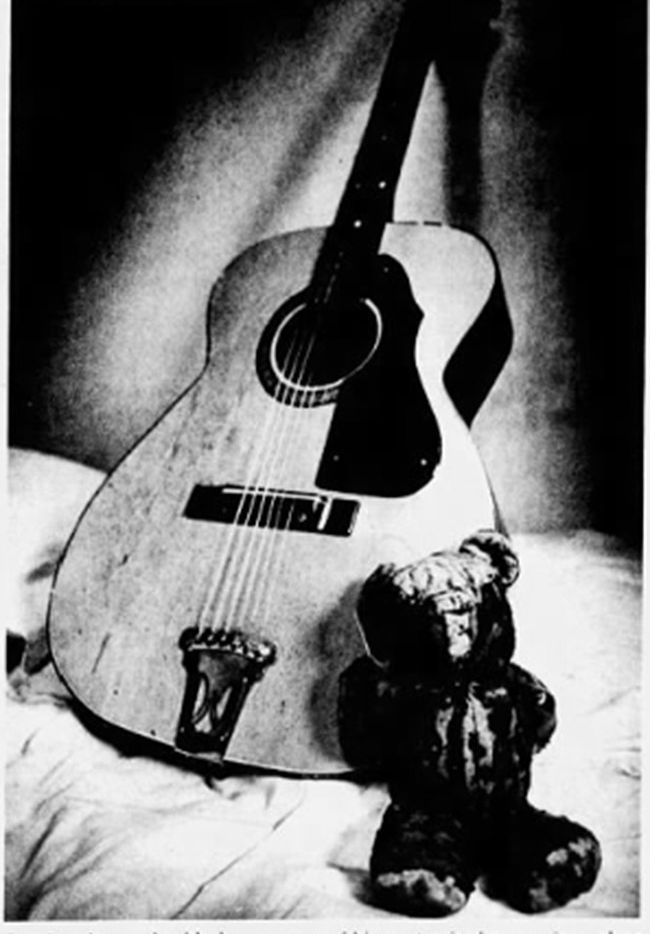 The Teddy Bear and guitar that belonged to Jesse Daniels, featured in the book Beneath a Ruthless Sun.