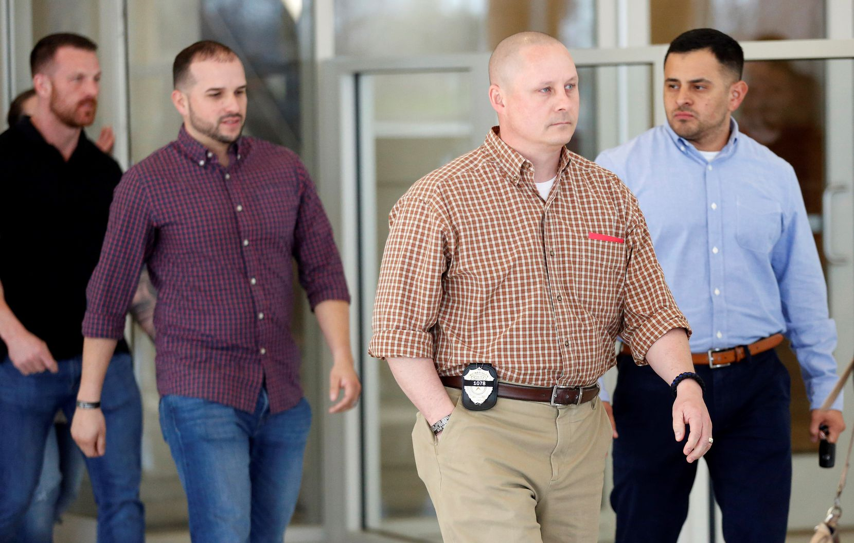 Fellow police officers of David Sherrard leave the Collin County Courthouse in McKinney after closing arguments in the sentencing of Brandon McCall on Thursday.