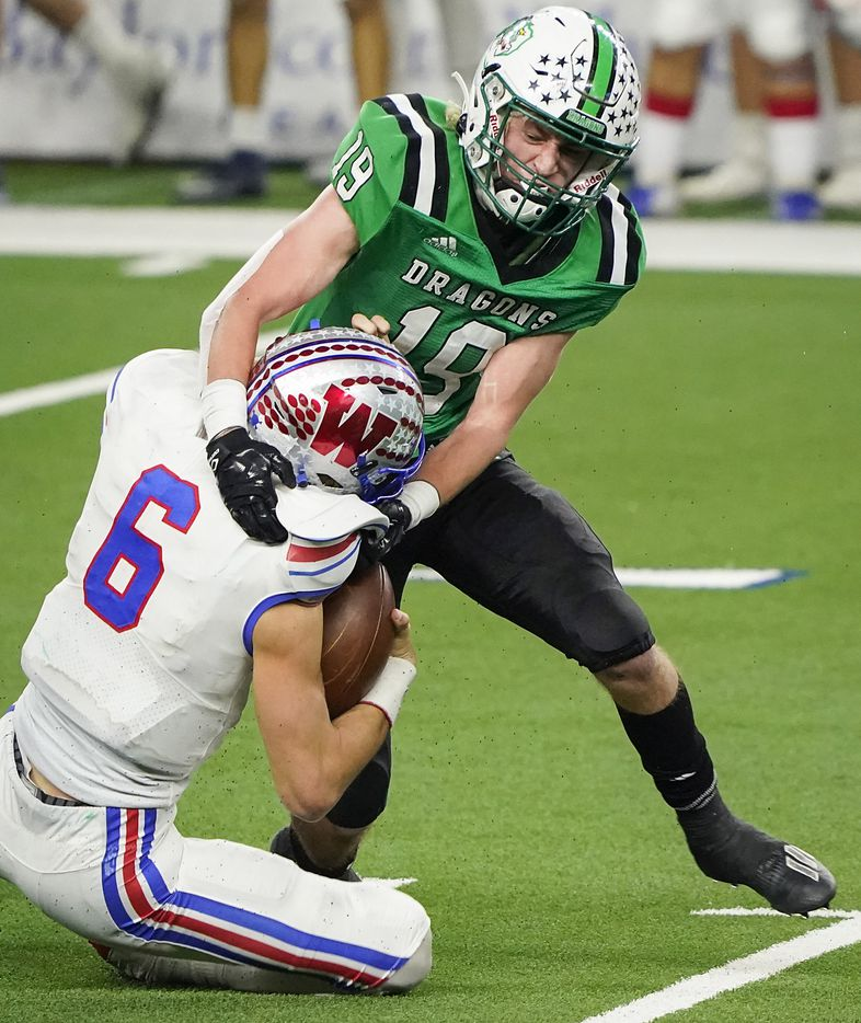 Austin Westlake quarterback Cade Klubnik (6) is sacked by Southlake Carroll defensive back Logan Anderson (19) during the third quarter of the Class 6A Division I state football championship game at AT&T Stadium on Saturday, Jan. 16, 2021, in Arlington, Texas.