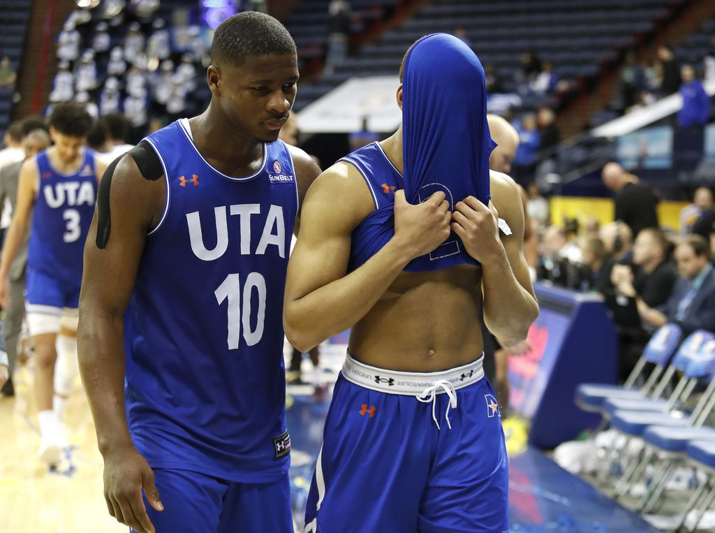 Texas-Arlington guard Radshad Davis (10) and guard Edric Dennis (5) walk off the court after the NCAA college basketball championship game of the Sun Belt Conference men's tournament in New Orleans, Sunday, March 17, 2019. (AP Photo/Tyler Kaufman)