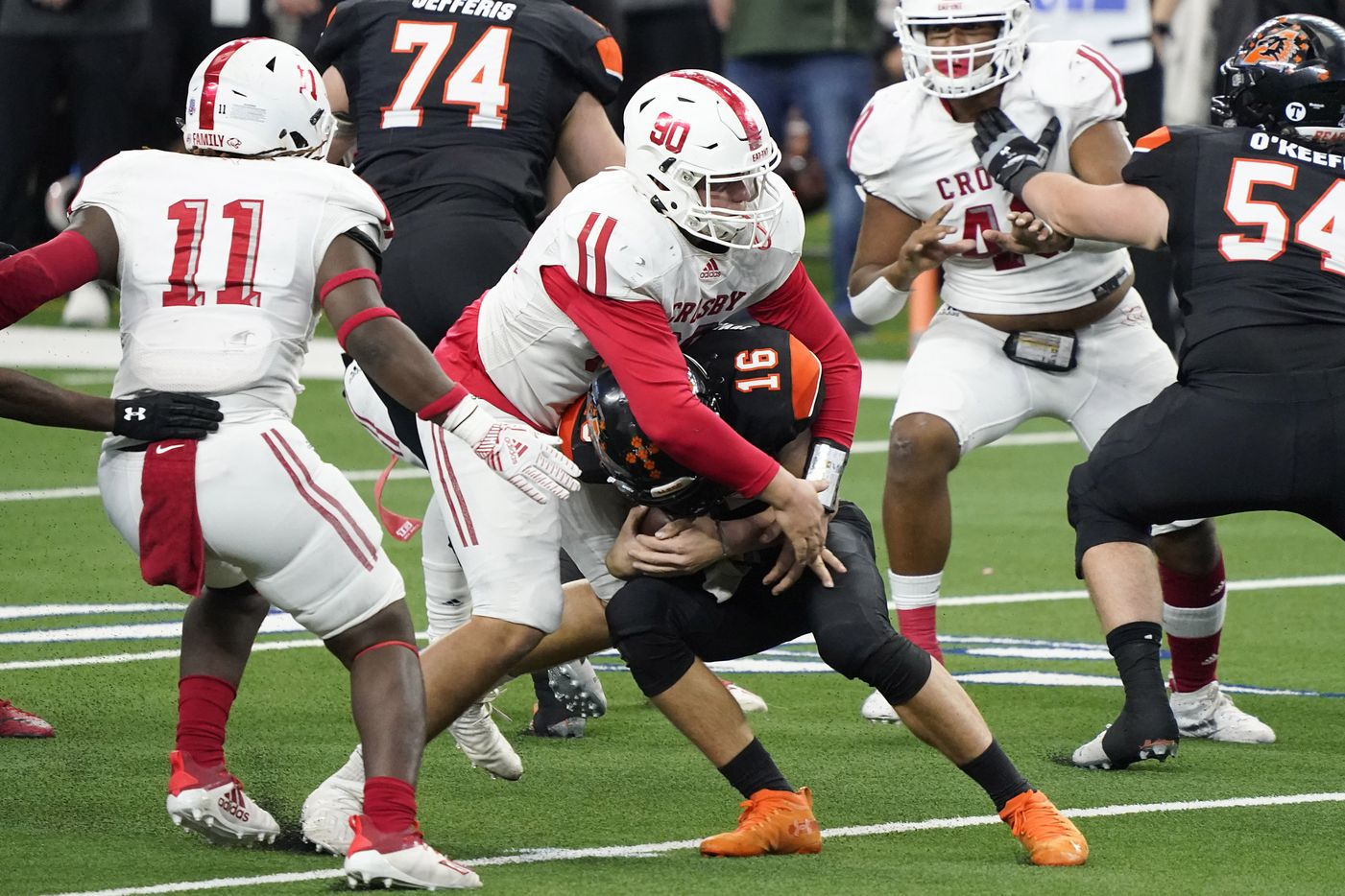 Aledo quarterback Brayden Fowler-Nicolosi (16) is sacked by Crosby defensive lineman Wade Lewis (90) during the first half of the Class 5A Division II state football championship game at AT&T Stadium on Friday, Jan. 15, 2021, in Arlington. (Smiley N. Pool/The Dallas Morning News)