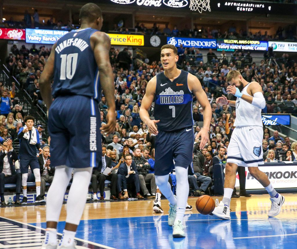 Dallas Mavericks forward Dwight Powell (7) reacts after forward Dorian Finney-Smith (10) scored during an NBA basketball game at American Airlines Center in Dallas on Saturday, March 2, 2019. (Shaban Athuman/The Dallas Morning News)