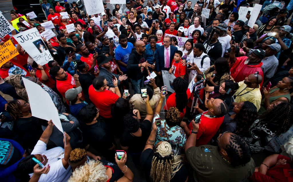 Frederick Douglass Haynes III talks to protesters during a protest in regards to the shooting of Botham Shem Jean on Sept. 10, 2018 at Jack Evans Police Headquarters in Dallas.