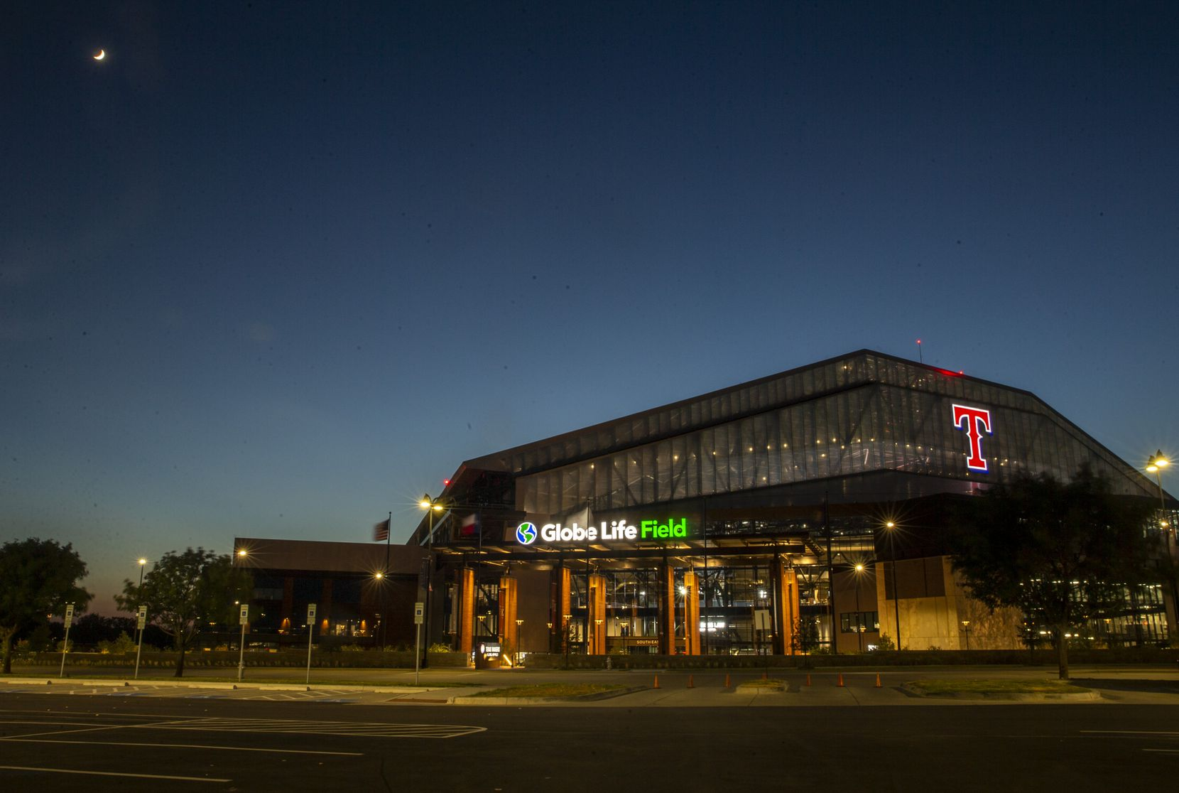 An adjacent parking lot sits empty by Globe Life Field during the opening day game of the Texas Rangers season at Texas Live! in Arlington, Texas, on Friday, July 24, 2020. The Rangers played the Colorado Rockies at the new Globe Life Field stadium, but fans had to watch on televised screens outside due to the ongoing pandemic. (Lynda M. Gonzalez/The Dallas Morning News)