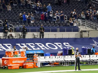 The Arizona Cardinals sideline sits empty during the national anthem before an NFL football game against the Dallas Cowboys at AT&T Stadium on Monday, Oct. 19, 2020, in Arlington.