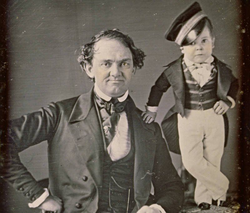 """In this 1850 photograph, P.T. Barnum poses with his international star """"General"""" Tom Thumb, his most popular attraction."""