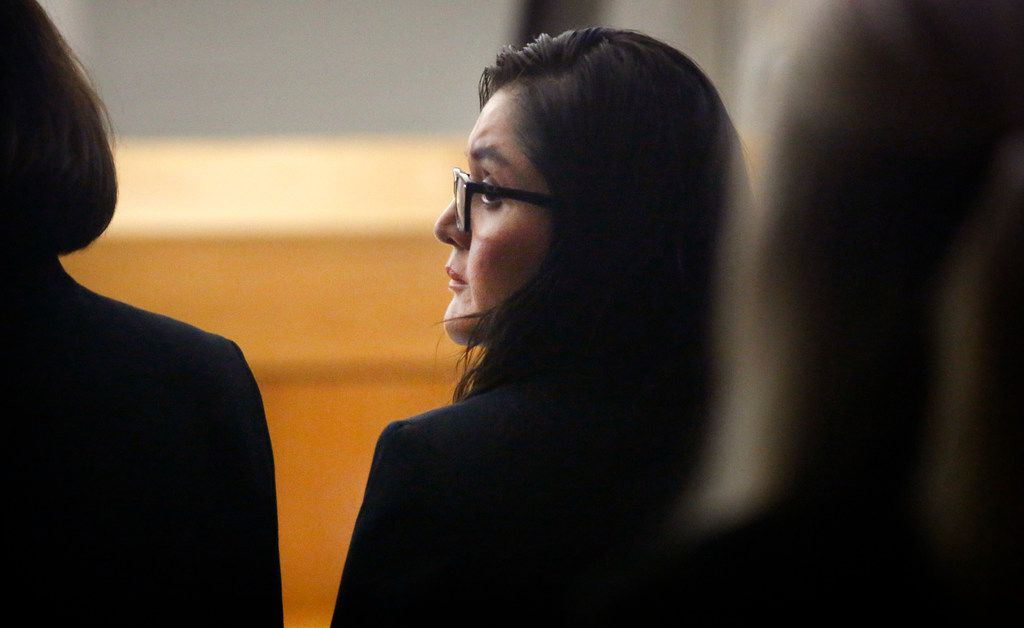 Defendant Brenda Delgado looks over her shoulder during her murder trial in the 363rd Judicial District Court at the Frank Crowley Courthouse in Dallas, Monday, June 3, 2019. Delgado is accused of hiring Crystal Cortes and Kristopher Love to kill Kendra Hatcher, an Uptown dentist. (Tom Fox/The Dallas Morning News)