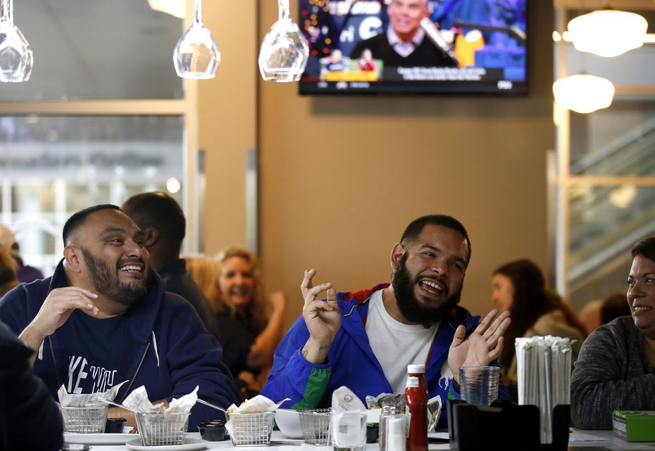 David Cortez (left) and Adrian Gonzales dine at the bar at Wahlburgers on opening day in Frisco. The restaurant had waits of up to two hours on Monday, Oct. 28, 2019.