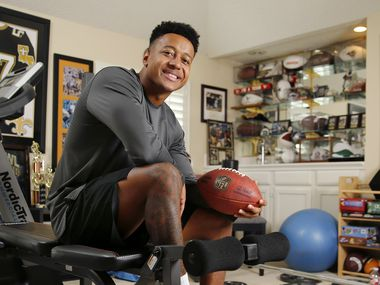 NFL Draft prospect Reid Harrison-Ducross, a Boise State football player who transferred to Duquesne University, poses for a photo in his family's workout room at their Grapevine, Texas home Friday, April 17, 2020. He hopes to be drafted next week even though his regional pro day tryout was canceled due to COVID-19.