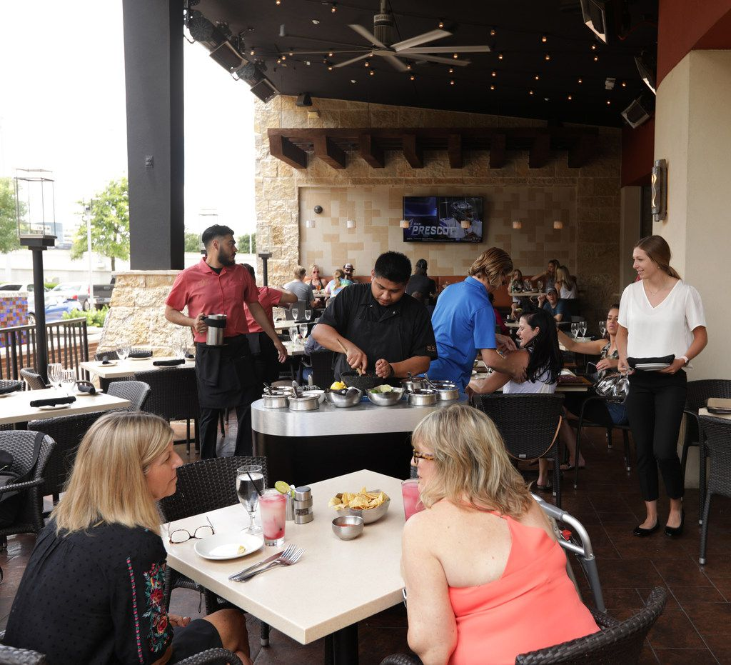 Guests enjoy the patio at Mi Dia From Scratch in Plano, TX, on Jun. 7, 2019. (Jason Janik/Special Contributor)