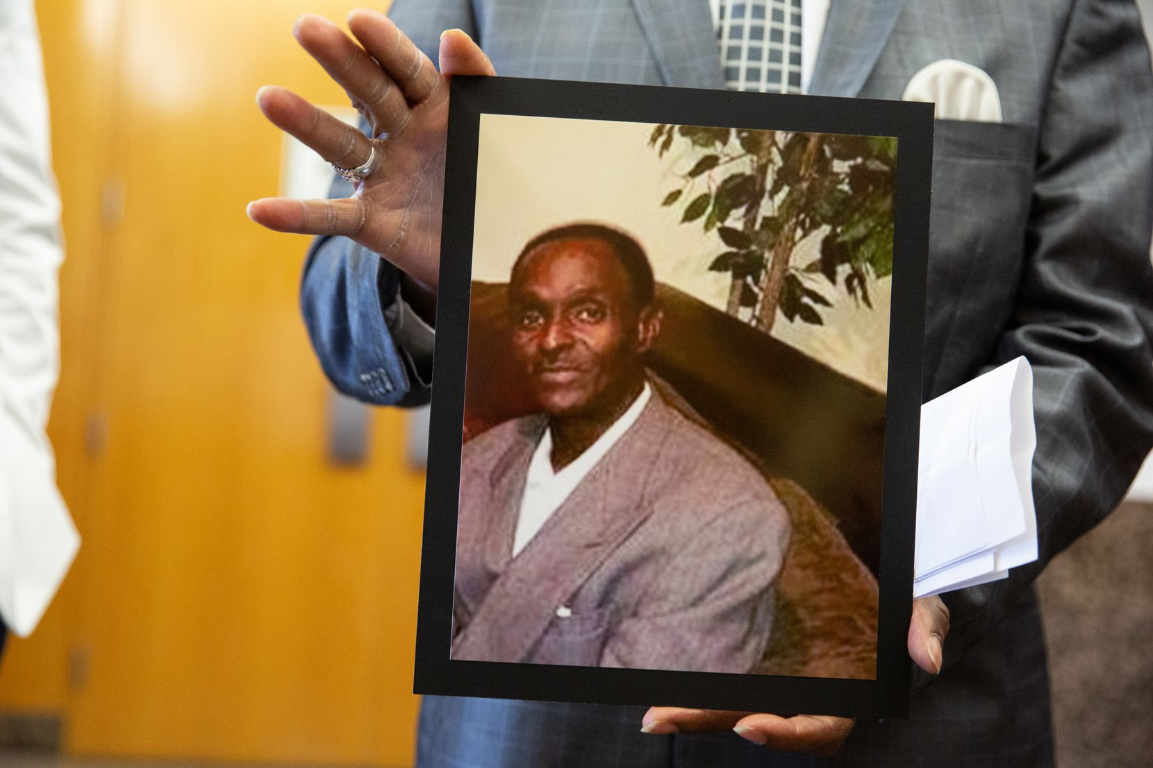 Kenneth R. Harris Sr. holds a photo of his 59-year-old brother Gerald Wayne Harris, who was killed by Reginal Knox, at Frank Crowley Courthouse on July 26, 2021. Knox pleaded guilty to murder in exchange for a 12-year sentence.