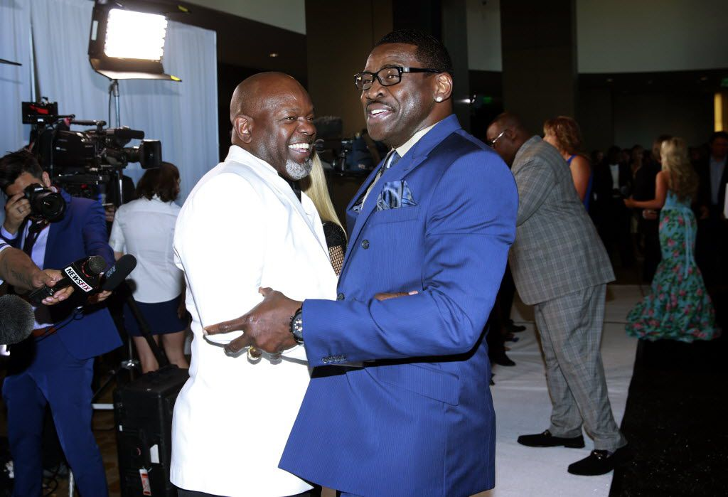 Former NFL Hall of Fame Dallas Cowboys Emmitt Smith (left) and Michael Irvin greet one another on the red carpet at the Emmitt Smith Celebrity Invitational charity gala held in the Omni Dallas, Friday, May 6, 2016. Joining them is Emmitt's wife Pat Smith (center). (Tom Fox/The Dallas Morning News)