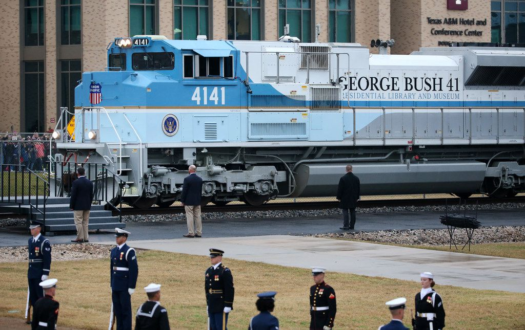 The custom-painted Union Pacific Locomotive 4141 pulling the funeral train arrives carrying the casket of former President George H.W. Bush to his final resting place at the George H. W. Bush Presidential Library Center on Texas A&M University campus in College Station, Texas on Thursday, Dec. 6, 2018. (Rose Baca/The Dallas Morning News)