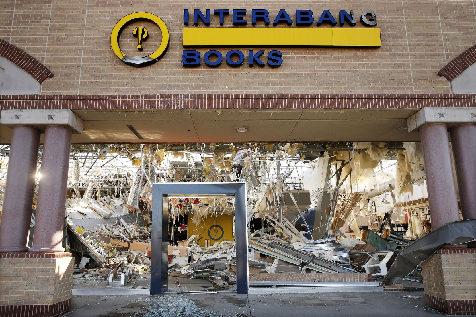 The interior of the Interabang Books store was demolished by a tornado in the Preston Royal shopping center in Dallas, Monday, October 21, 2019. A tornado tore through the entire shopping center. (Tom Fox/The Dallas Morning News)