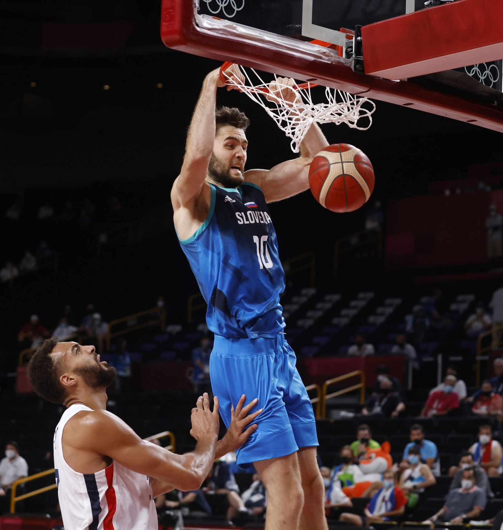 Slovenia's Mike Tobey (10) dunks the ball in front of France's Rudy Gobert (27) during the first half of a men's basketball semifinal at the postponed 2020 Tokyo Olympics at Saitama Super Arena, on Thursday, August 5, 2021, in Saitama, Japan. (Vernon Bryant/The Dallas Morning News)
