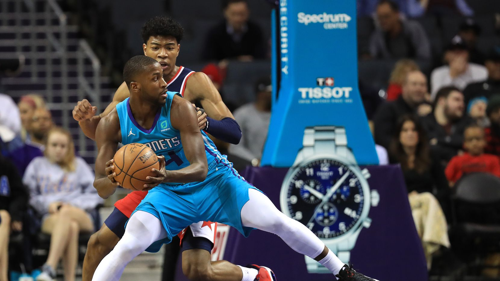 CHARLOTTE, NORTH CAROLINA - DECEMBER 10: Michael Kidd-Gilchrist #14 of the Charlotte Hornets drives to the basket against Rui Hachimura #8 of the Washington Wizards during their game at Spectrum Center on December 10, 2019 in Charlotte, North Carolina.