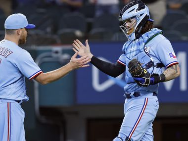 Texas Rangers relief pitcher Ian Kennedy (31) is congratulated by catcher Jonah Heim (28) after getting the save in the ninth inning against the Kansas City Royals at Globe Life Field in Arlington, Texas, Friday, June 27, 2021. The Rangers won, 4-1. (Tom Fox/The Dallas Morning News)