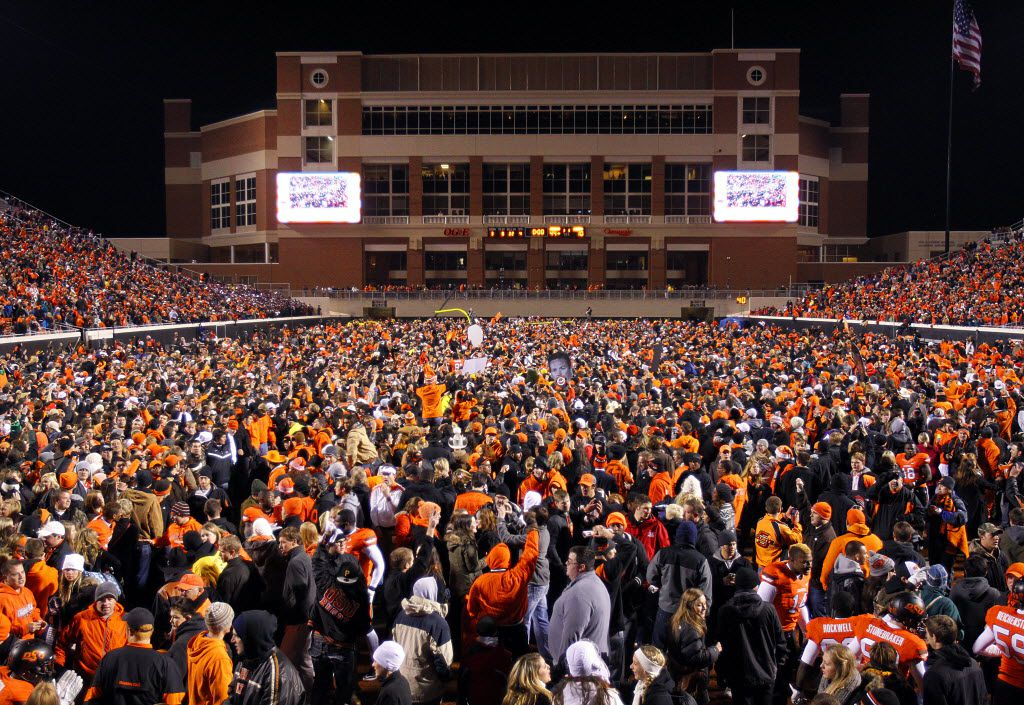 It was bedlam following Oklahoma State's win over Oklahoma as fans flooded the field at Boone Pickens Stadium in Stillwater, OK, Saturday, December 3, 2011.  OSU won the Big XII title with their 44-10 win. (Tom Fox/The Dallas Morning News)