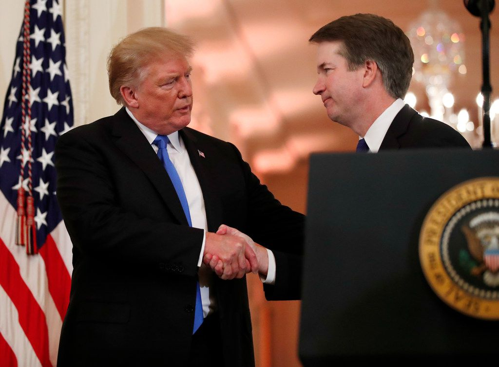 President Donald Trump shakes hands with Judge Brett Kavanaugh, his Supreme Court nominee, in the East Room of the White House on Monday, July 9, 2018.   (AP Photo/Alex Brandon)