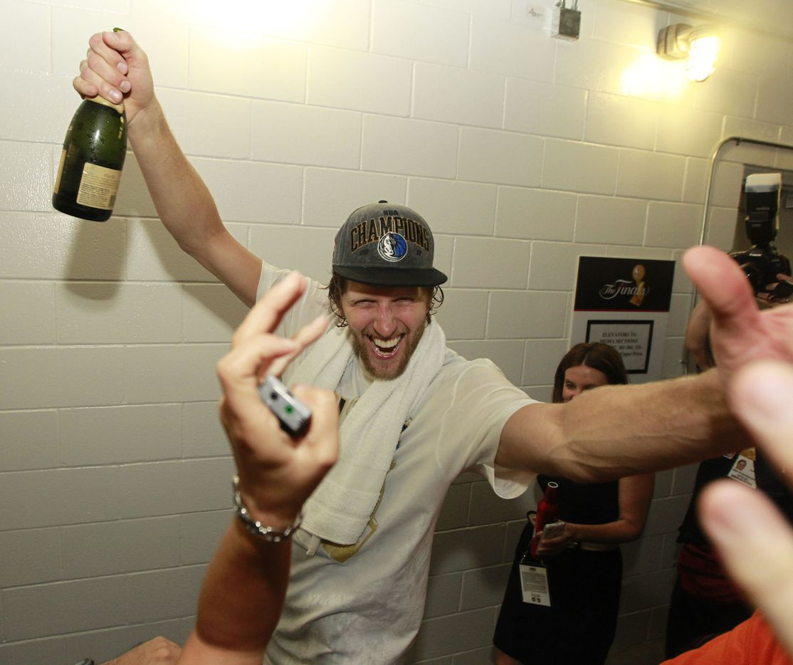 Dallas Mavericks player Dirk Nowitzki celebrates after they won game six of the NBA Finals between the Miami Heat and the Dallas Mavericks at the American Airlines Arena in Miami, Florida, June 12, 2011. The Mavericks won 105-95 to take the title.     (Michael Ainsworth/The Dallas Morning News)