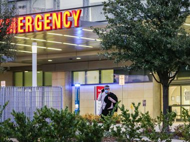 Parkland Memorial Hospital's emergency entrance in Dallas on Tuesday, December 29, 2020. The hospital has about 10% more COVID-19 patients today than it did during its summer surge. (Lola Gomez/The Dallas Morning News)