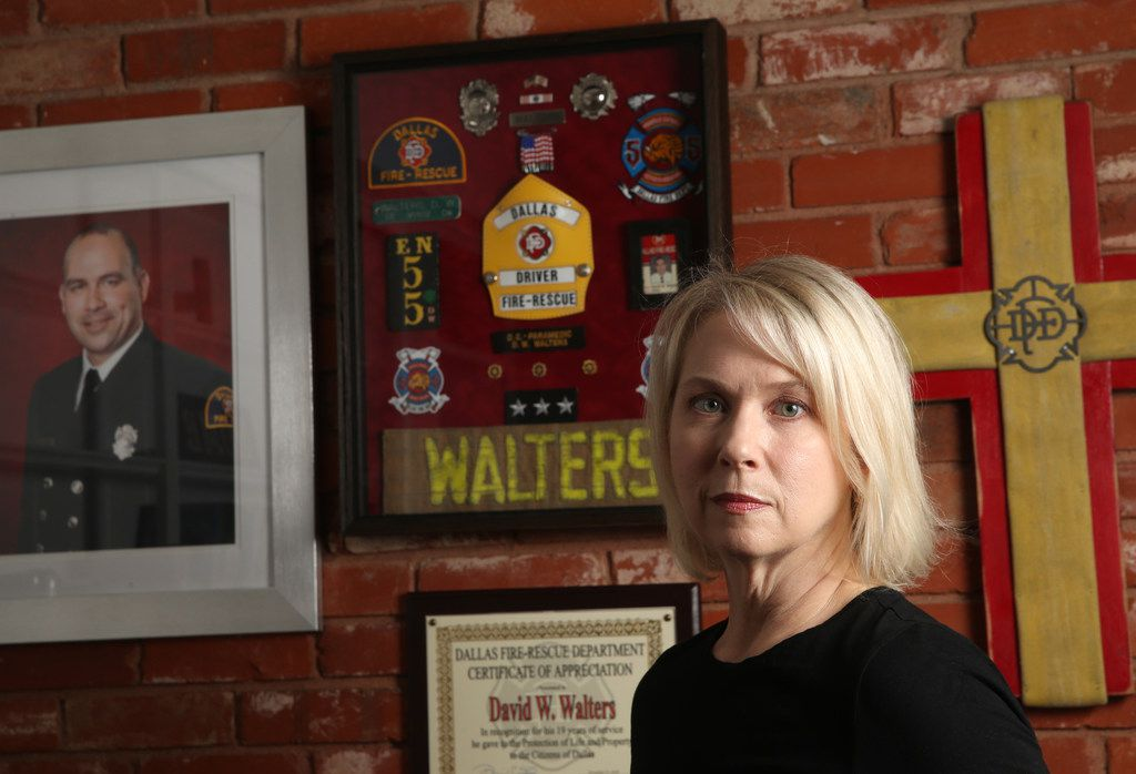 Kristi Walters, wife of Dallas firefighter David Walters who died suddenly last November, poses for a photograph at her home in Dallas on Friday, May 3, 2019.
