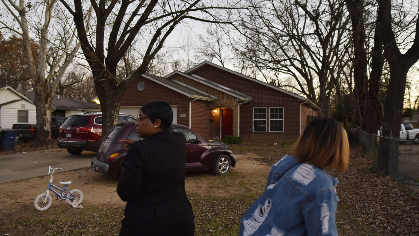 Ella Mae Beasley, 57, left, and her niece walked by the home where 1-year-old Rory Norman was shot and killed early Sunday morning on Valentine Street in South Dallas, Jan. 5, 2020.