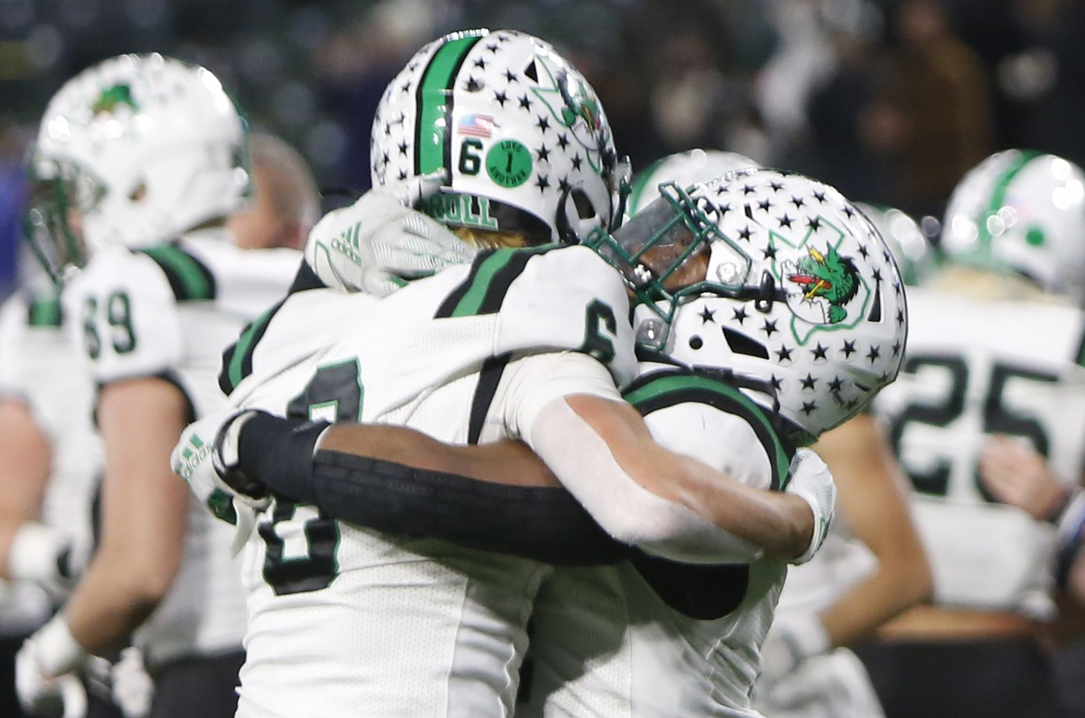 Southlake Dragons players Landon Samson (6), left, and Cinque Williams (4) celebrate the team's 30-26 victory over Arlington Martin to advance. The two teams played their Class 6A Division l Region l semifinal football playoff game held at Globe Life Park in Arlington on December 24, 2020. (Steve Hamm/ Special Contributor)