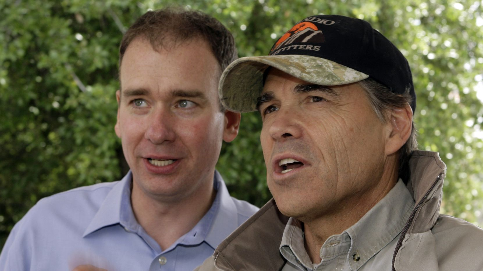 """Michael Quinn Sullivan (left) spoke to then-Gov. Rick Perry before a """"Don't Mess With Texas"""" tea party rally in Austin in 2009. Read further in our Washington points for some news about Perry, too. (Harry Cabluck/Associated Press)"""