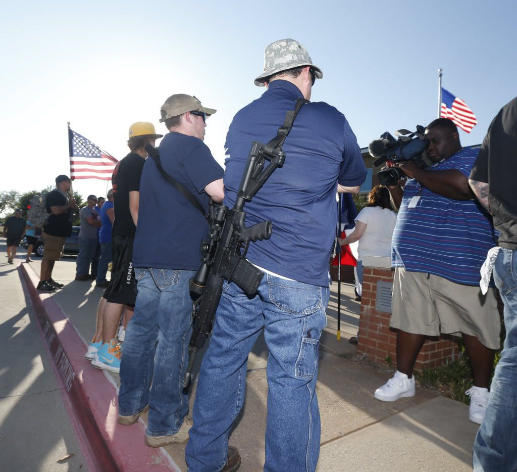 Open carry supporters attended a counterprotest in front of the McKinney Police Department in June 2015.