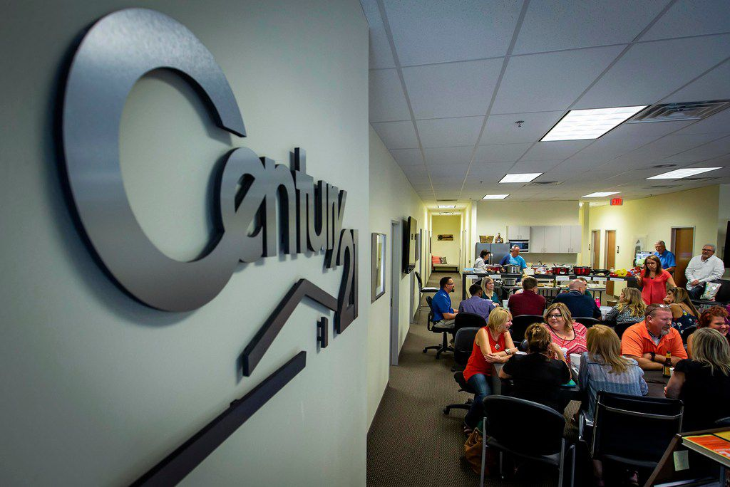 Realtors gather for a happy hour at Century 21 Judge Fite offices in Mansfield.