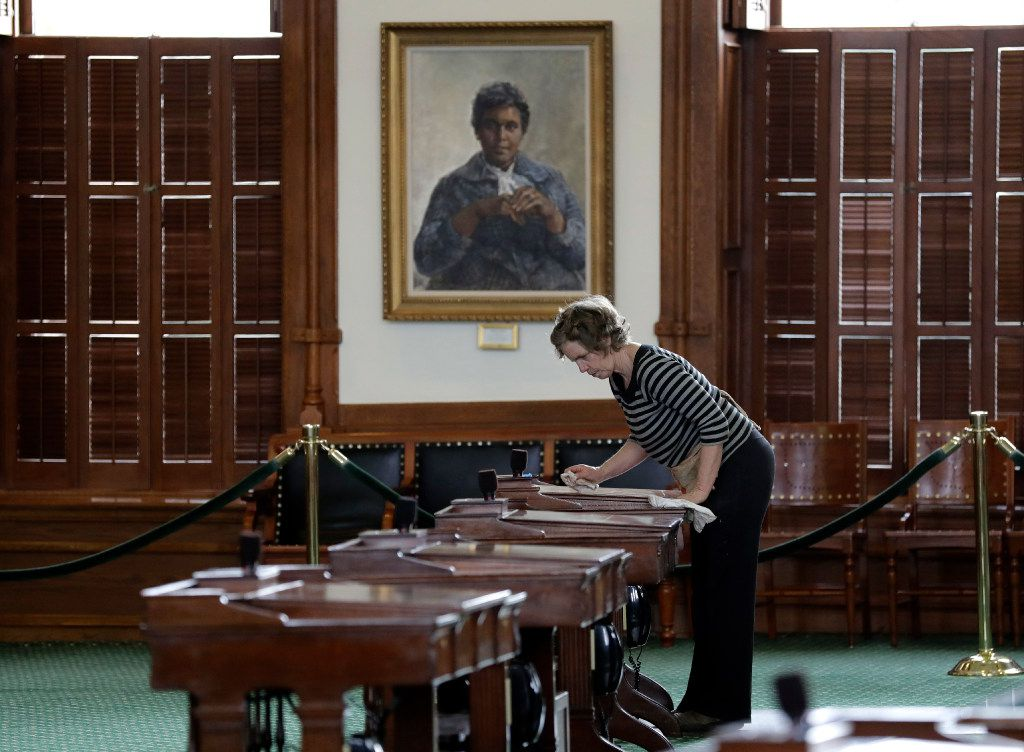 Mara Eurich waxes desks in the Senate Chamber at the Texas Capitol, Wednesday, Jan. 4, 2017, in Austin, Texas. The 85th Texas Legislative session begins Jan. 10. (AP Photo/Eric Gay)