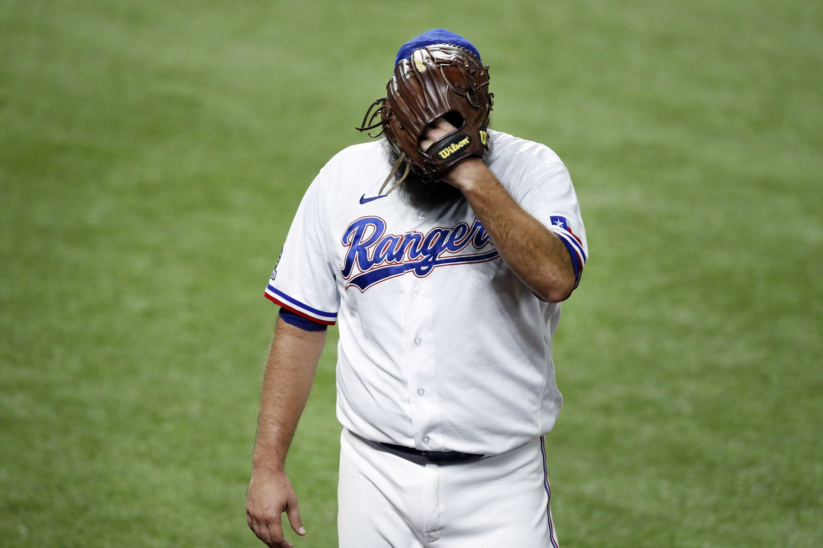 Texas Rangers starting pitcher Lance Lynn (35) covers his face as he walks to the dugout during the fourth inning in which he hit Los Angeles Angels batter Justin Upton at Globe Life Field in Arlington, Texas, Tuesday, September 8, 2020. Upton left the game. (Tom Fox/The Dallas Morning News)