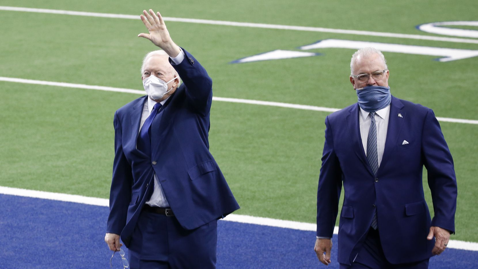 Dallas Cowboys owner and general manager Jerry Jones waves to fans as he walks off the field with Dallas Cowboys executive vice president Stephen Jones during pregame activities for the home opener between the Dallas Cowboys and Atlanta Falcons at AT&T Stadium in Arlington, Texas on Sunday, September 20, 2020.