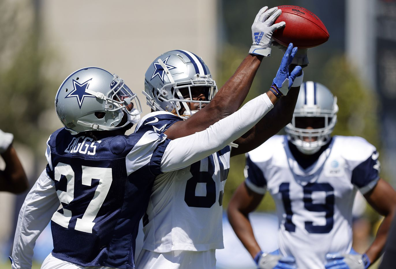 Dallas Cowboys cornerback Trevon Diggs (27) trees to knock the ball from Dallas Cowboys wide receiver Noah Brown's (85) hands during Training Camp practice drills at The Star in Frisco, Texas, Tuesday, August 24, 2021.(Tom Fox/The Dallas Morning News)