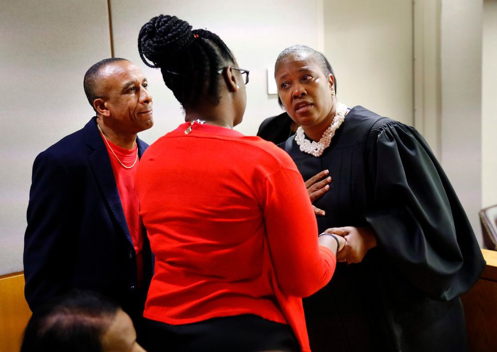Judge Tammy Kemp gives her sympathies to Botham Jean's parents, Allison and Bertrum Jean (left), following the 10-year sentence given to Amber Guyger for murder at the Frank Crowley Courts Building in Dallas, Wednesday, October 2, 2019.  Fired Dallas police Officer Amber Guyger was found guilty of murder by a 12-person jury. Guyger shot and killed Botham Jean, an unarmed 26-year-old neighbor,  in his own apartment last year. She told police she thought his apartment was her own and that he was an intruder.