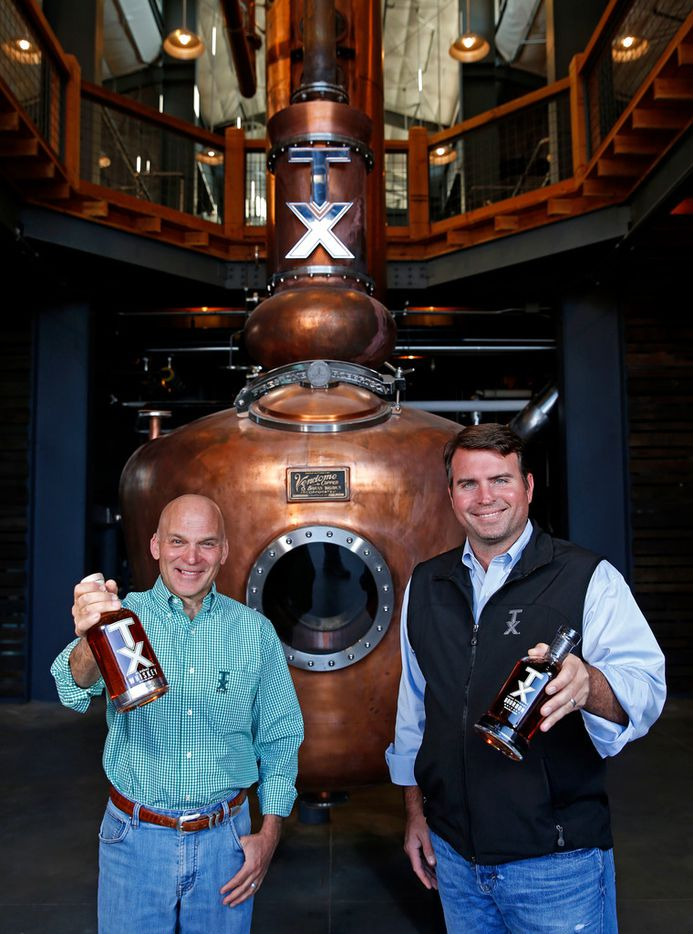 Founders of Firestone and Robertson Distillery Leonard Firestone (left) and Troy Robertson pose for a photograph inside the stillhouse on Wednesday, Nov. 1, 2017, in Fort Worth, Texas. (Jae S. Lee/The Dallas Morning News)