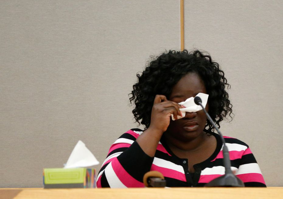 Jordan Edwards' mother, Charmaine Edwards, wipes away tears Thursday during a court hearing for Roy Oliver, the former cop who is charged with murder in the boy's death.