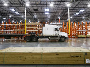 Workers stock a Home Depot distribution center on Tuesday, Jan. 28, 2020 in Dallas. (Ryan Michalesko/The Dallas Morning News)